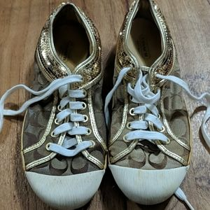 Used Coach gold tennis shoes size 9B